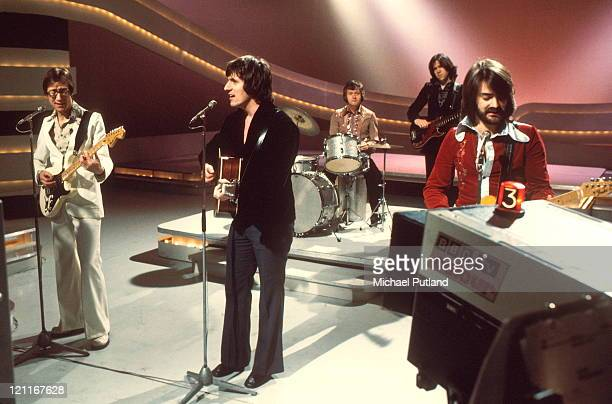 Group portrait of The Shadows on teh set of a TV show London LR Hank Marvin Bruce Welch Brian Bennett Alan Tarney John Farrar