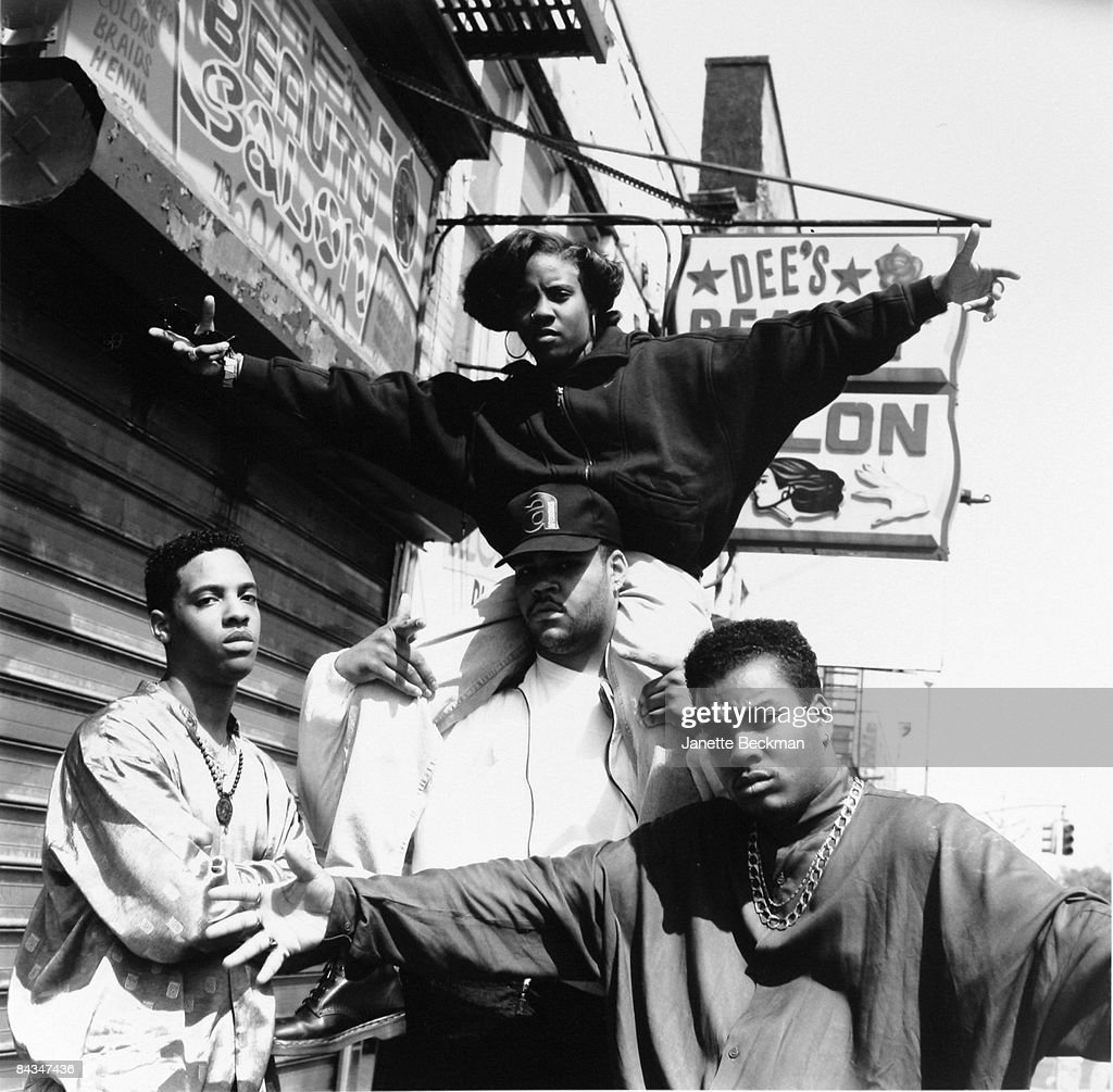 Group portrait of various hip hop and rapping artists, from left (bottom row): Tony 'Master T' Young, Big Drew, and K Rock. Sitting upon Big Drew's shoulders is MC Lyte, 1990. New York.