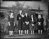 Group portrait standing in interior for reception sponsored by YWCA of Pittsburgh Pittsburgh Pennsylvania March 1944 From left unknown First Lady...