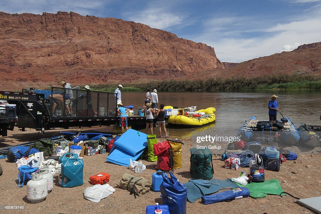 LEE'S FERRY AR JULY 14 A group prepares to embark on a 16day journey down the Colorado River on rafts through the Grand Canyon on July 14 2014 at...