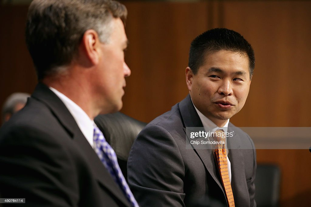 Group President and CEO Bradley Katsuyama (R) and Notre Dame Finance Professor Robert Battalio prepare to testify before the Senate Homeland Security and Governmental Affairs Investigations Subcommittee about high speed stock trading in U.s. markets in the Hart Senate Office Building on Capitol Hill June 17, 2014 in Washington, DC. The committee heard testimony from experts and executives about conflicts of interest and the loss of investor confidence due to high speed trading.