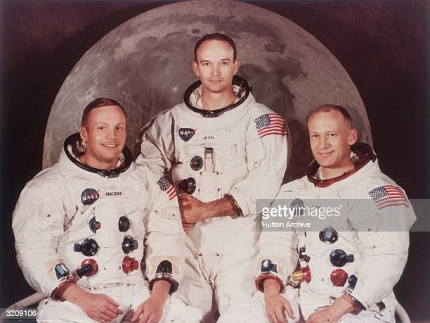 Group publicity portrait of Apollo 11 astronauts Neil Armstrong Michael Collins and Edwin 'Buzz' Aldrin wearing spacesuits