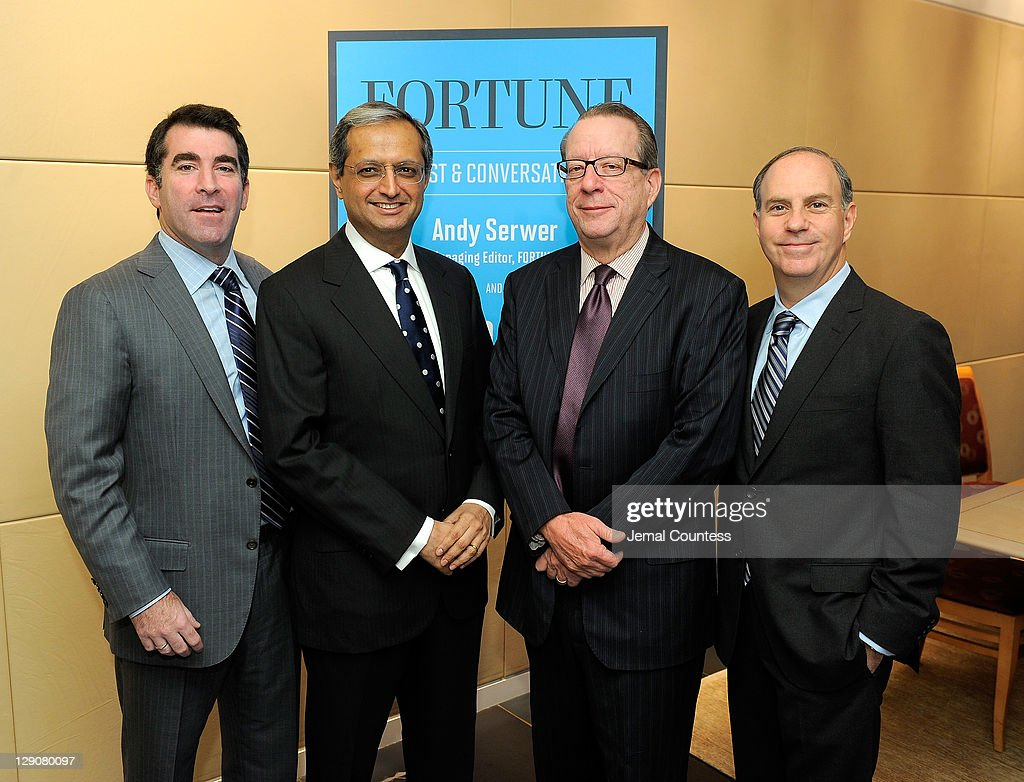 Group Publisher, Fortune Money Group Jed Hartman, CEO of Citigroup <a gi-track='captionPersonalityLinkClicked' href=/galleries/search?phrase=Vikram+Pandit&family=editorial&specificpeople=5610048 ng-click='$event.stopPropagation()'>Vikram Pandit</a>, Editor and Chief of Time Inc. John Huey and Fortune Magazine Managing Editor Andrew Serwer pose for a photo at the FORTUNE Breakfast & Conversation with <a gi-track='captionPersonalityLinkClicked' href=/galleries/search?phrase=Vikram+Pandit&family=editorial&specificpeople=5610048 ng-click='$event.stopPropagation()'>Vikram Pandit</a>, CEO, Citigroup at TIME Building on October 12, 2011 in New York City.