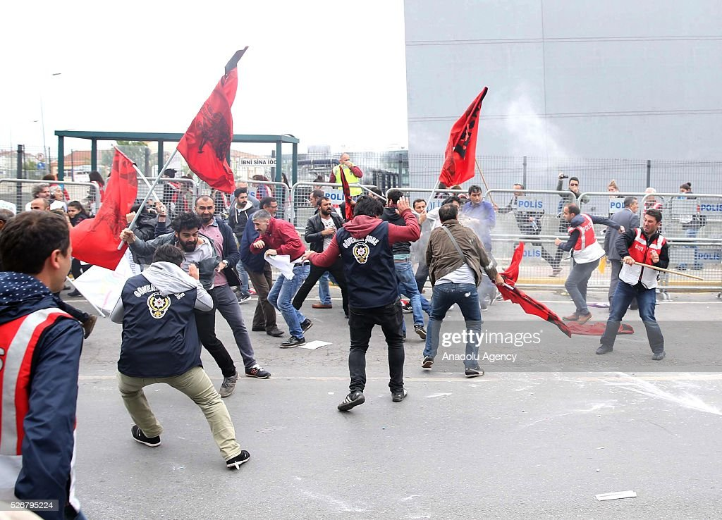 A group, rejecting police's security check and carrying illegal materials clash with riot police as they try to enter the open market area in the Bakirkoy neighborhood, where main May Day celebrations take part on May 01, 2016 in Istanbul, Turkey. Every year May Day is observed and commemorated as an official holiday all around Turkey.