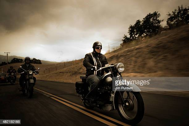 Group riding motorcycles on rural road