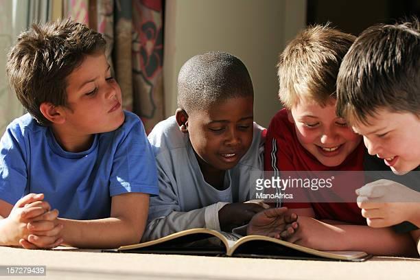 group schoolboy friends reading