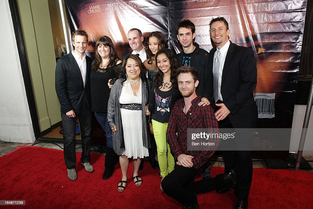 A group shot including Megan Griffiths, Chong Kim, <a gi-track='captionPersonalityLinkClicked' href=/galleries/search?phrase=Jamie+Chung&family=editorial&specificpeople=4145549 ng-click='$event.stopPropagation()'>Jamie Chung</a>, Scott Mechlowicz and Matt O'Leary attend the premiere of 'Eden' at Laemmle Music Hall on March 28, 2013 in Beverly Hills, California.