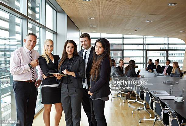 Group shot of business people with tablet