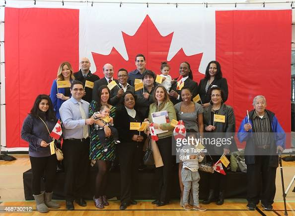Group shot of new Canadians who originate from countries that are competing in Pan Am Games pose for pictures at the Pan Am Games celebration 100day...