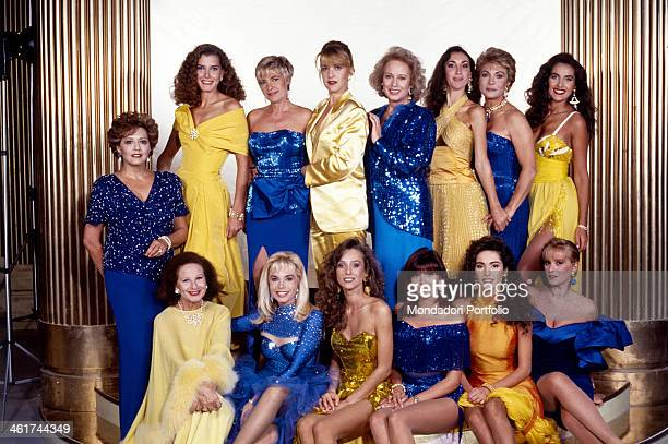 Group shot of the RAI and Fininvest announcers wearing elegant evening dresses yellowcoloured and bluecoloured from the left standing are Maria...