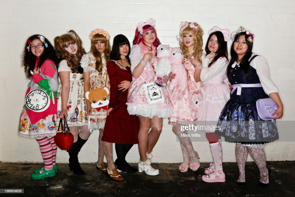 A group shot of visitors all in 'Sweet Lolita' fashion attend Hyper Japan at Earl's Court on November 24, 2012 in London, England. Hyper Japan is the UK's biggest Japanese culture event with many of the visitors dressing as cosplay, anime and manga characters.