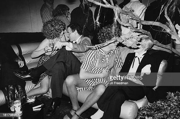 A group sit talking on the sofa in Studio 54 New York City 1979
