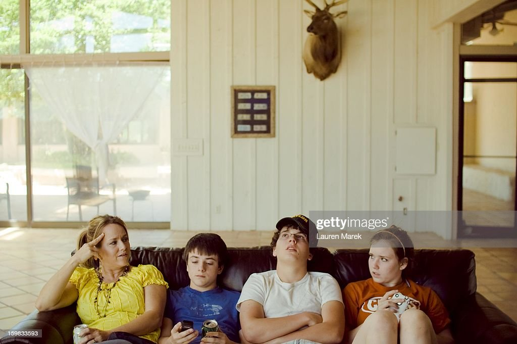 CONTENT] A group sits on the couch, in a candid moment of home life in Texas.