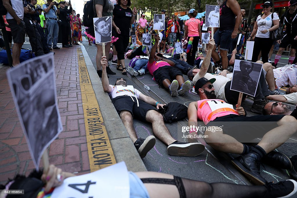 A group stages a die-in as they honor the victims of the Orlando nightclub shooting during the 2016 San Francisco Pride Parade on June 26, 2016 in San Francisco, California. Hundreds of thousands of people came out to watch the annual San Francisco Pride parade, one of the largest in the world.
