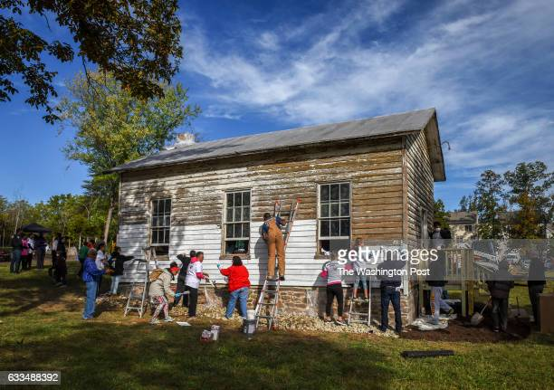 A group tackles painting the exterior as volunteers gather to restore the Ashburn Colored School a nineteenthcentury schoolhouse recently vandalized...