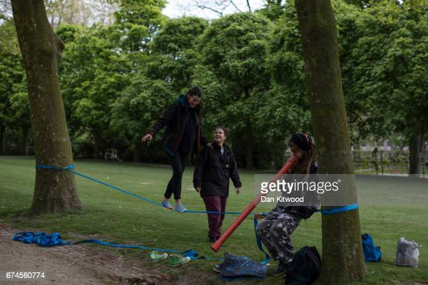 A group take turns balancing on a slackline in a park on April 28 2017 in Brussels Belgium The 27 members of the European Union will meet in Brussels...