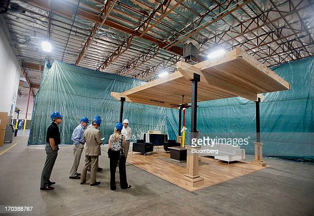 A group tours the Sunora Energy Solutions LCC facility in Phoenix Arizona US on Tuesday June 11 2013 Solar installations in the first quarter...
