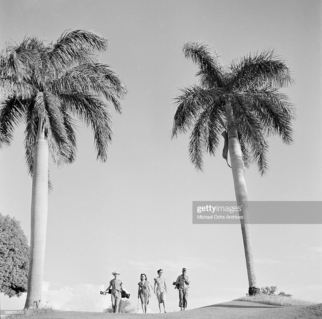 A group walks the golf course during a golf game in Havana, Cuba.