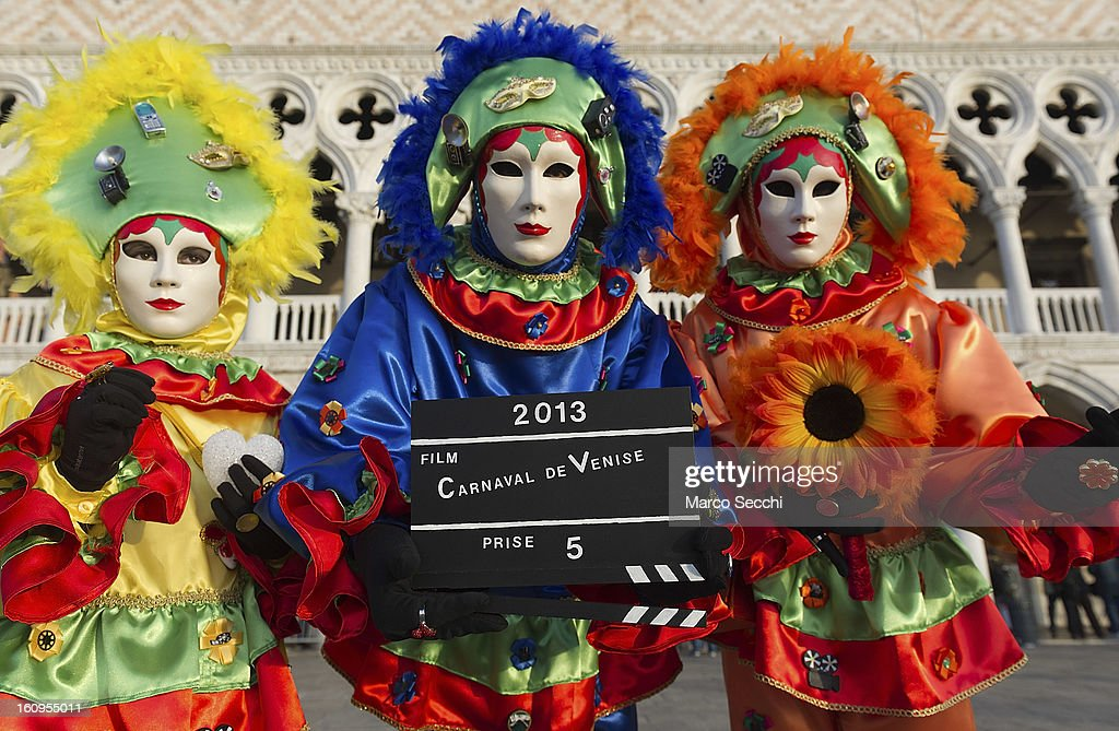A group wearing a carnival costumes pose in front of the Doge Palace on February 8, 2013 in Venice, Italy. The 2013 Carnival of Venice runs from January 26 - February 12 and includes a program of gala dinners, parades, dances, masked balls and music events.