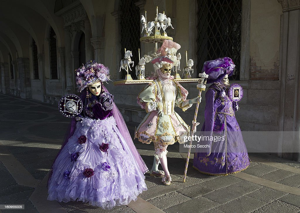 A group wearing a carnival costumes pose in Saint Mark's Square on February 8, 2013 in Venice, Italy. The 2013 Carnival of Venice runs from January 26 - February 12 and includes a program of gala dinners, parades, dances, masked balls and music events.