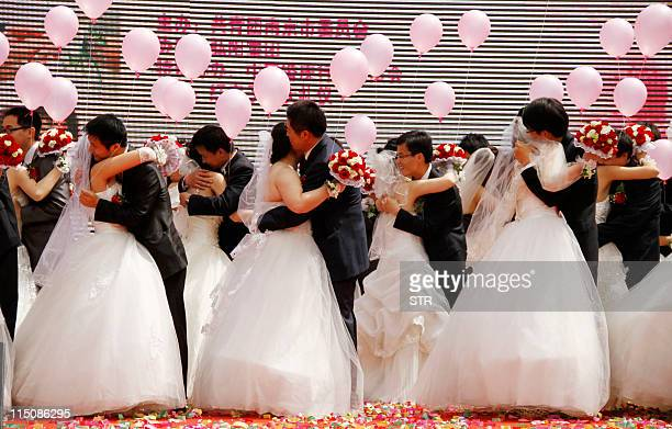 A group wedding couples takes part in a mass wedding ceremony at a park in Nanjing in eastern China's Jiangsu province on May 1 2011 The event was...