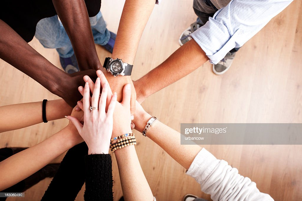 Group with hands together : Stock Photo