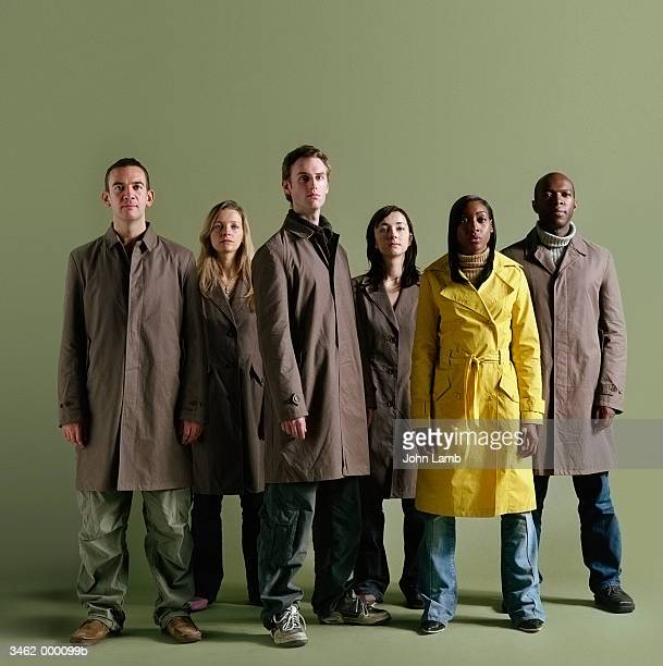 Group with One in Yellow Coat
