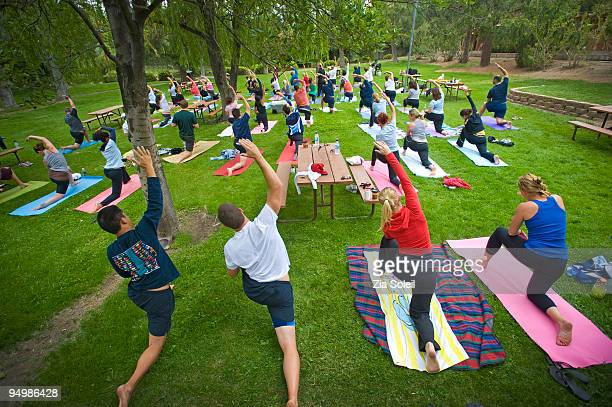 group yoga session in public park