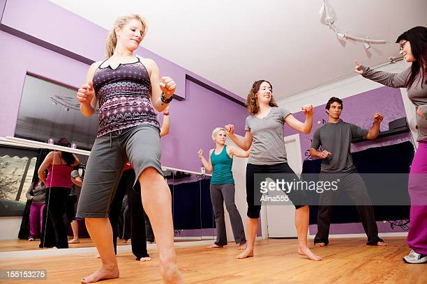 Group zumba class in a small fitness studio