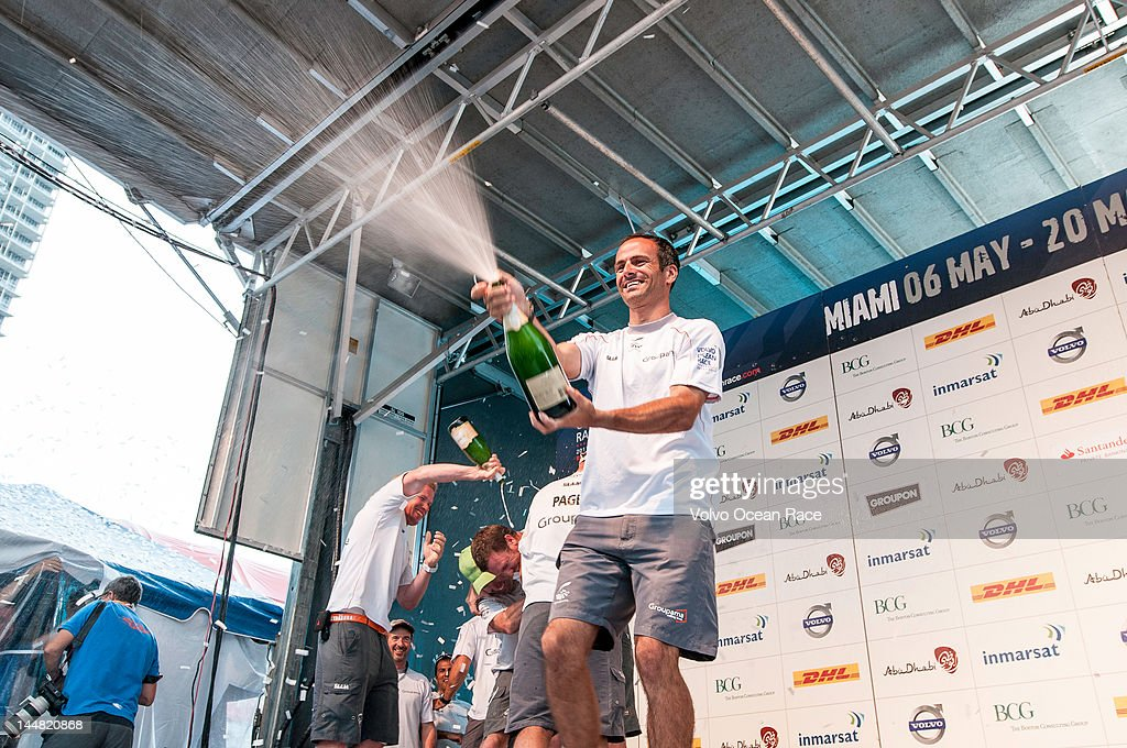 Groupama Sailing Team, skipper <a gi-track='captionPersonalityLinkClicked' href=/galleries/search?phrase=Franck+Cammas&family=editorial&specificpeople=773410 ng-click='$event.stopPropagation()'>Franck Cammas</a> from France, sprays champagne in celebration of taking second place in the PORTMIAMI In-Port Race, during the Volvo Ocean Race 2011-12 on May 19, 2012 in Miami, Florida.