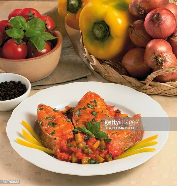 Grouper steaks with tomato sauce