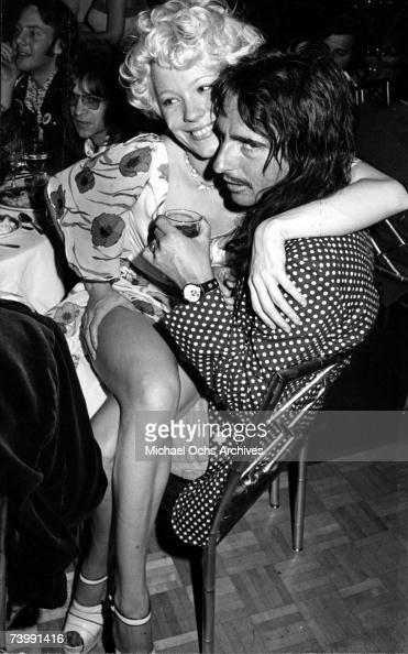 Groupie Miss Pamela snuggles with rock star Alice Cooper Circa 1974 in Los Angeles California