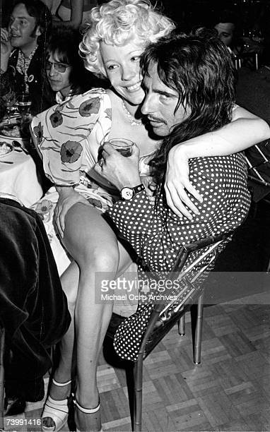 Groupie Miss Pamela snuggles with rock star Alice Cooper Circa 1974 in Los Angeles California