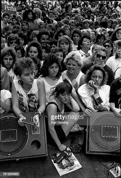 JUN 16 1987 Groupies gather around hoping to get a look at rock star Jon Bon Jovi who was to show up a rally Pena had on the 16th st Mall The rock...
