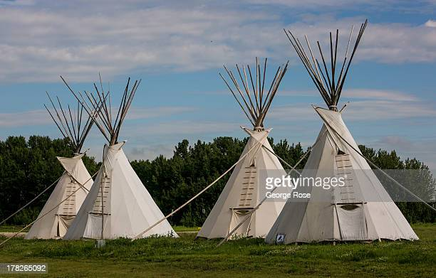 A grouping of Indian teepees line the entrance to the River Cree Resort Casino on June 24 2013 in Edmonton Alberta Canada Edmonton along with its...