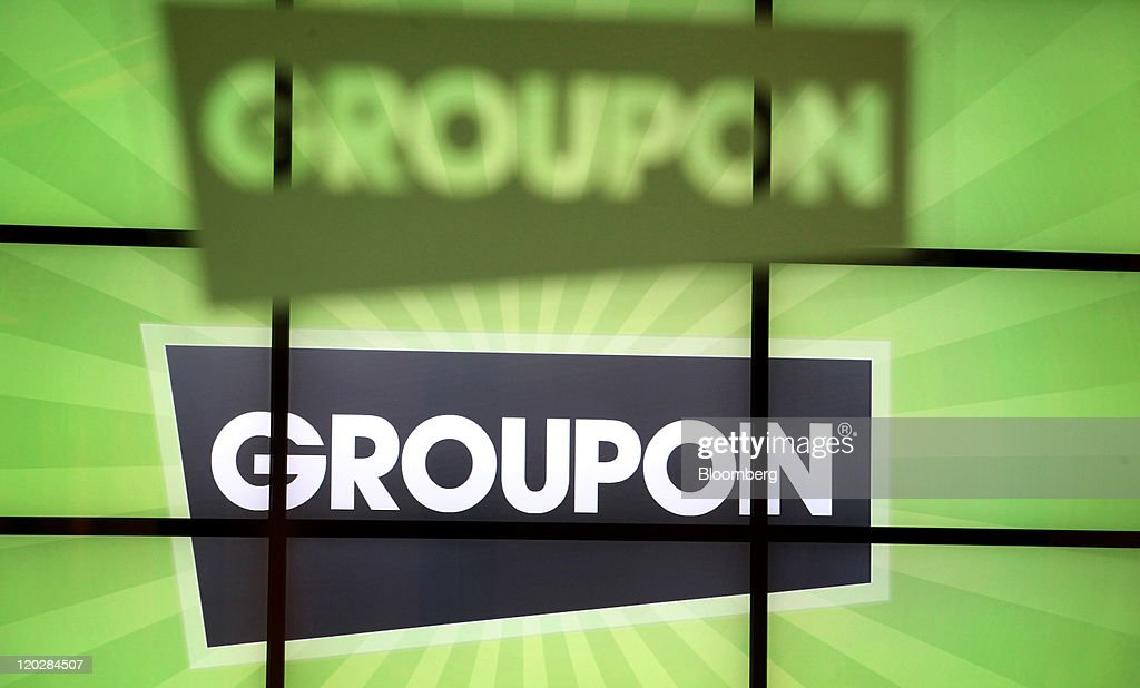 Groupon Inc signage is displayed at company headquarters in Chicago Illinois US on Wednesday Aug 3 2011 Chicago Ideas Week is the platform for ideas...