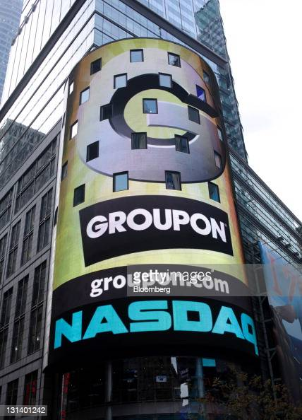 Groupon Inc signage is displayed on a screen outside of the Nasdaq MarketSite in New York US on Friday Nov 4 2011 Groupon Inc relied on some of...