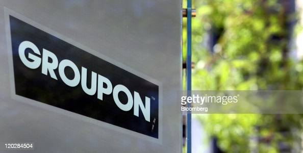 Groupon Inc signage is displayed outside of company headquarters in Chicago Illinois US on Wednesday Aug 3 2011 Chicago Ideas Week is the platform...