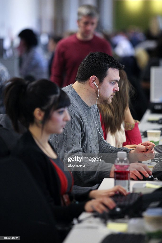 Groupon Inc team members work at the company's headquarters in Chicago Illinois US on Tuesday Dec 14 2010 Groupon the startup provider of online...