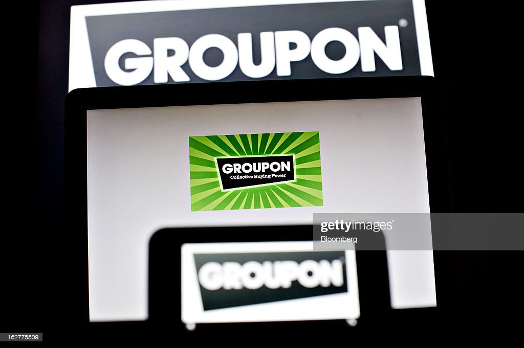 Groupon.com logos are displayed for a photograph in Tiskilwa, Illinois, U.S., on Tuesday, Feb. 26, 2013. Groupon Inc., operator of the largest daily-deals website, is scheduled to report quarterly earnings on Feb. 27. Photographer: Daniel Acker/Bloomberg via Getty Images