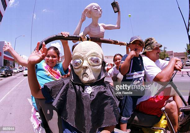 Groups dressed as aliens ride through downtown Roswell New Mexico July 1 2000 as they participate in the annual UFO Encounter which runs through July...