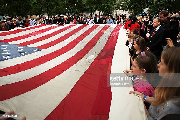 Groups of children join firefighters police members of the military and the public in participating in the ceremonial transfer of the National 9/11...