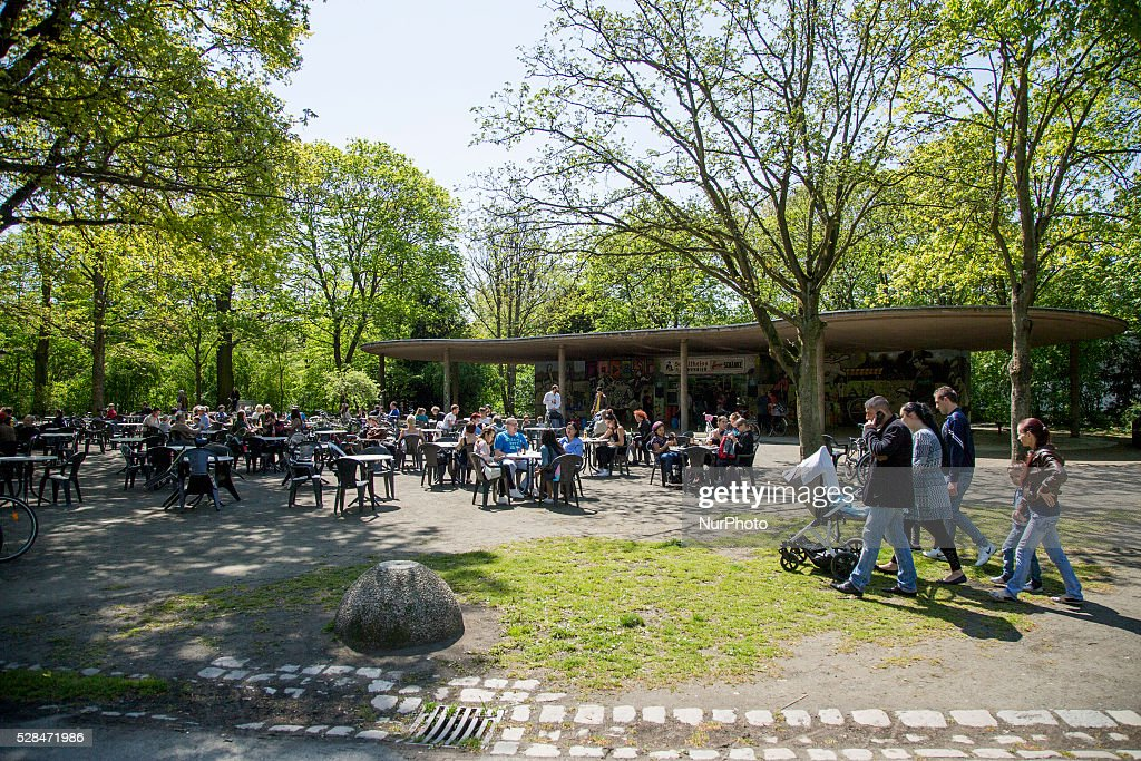 Groups of people enjoy the sun and sit at the tables of a bar in the Hasenheide park during Father's Day or Man's Day in Berlin, Germany on May 5, 2016.