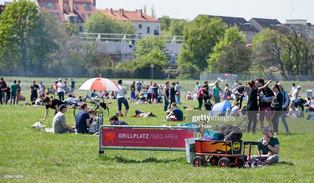 Groups of people enjoy the sun in the Tempelhofer Feld park during Father's Day or Man's Day in Berlin, Germany on May 5, 2016. In Germany is tradition on this day for groups of males to do a hiking tour with food and drinks and use this holiday as opportunity to get drunk.