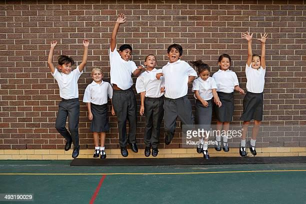 Groupshot of classmates jumping