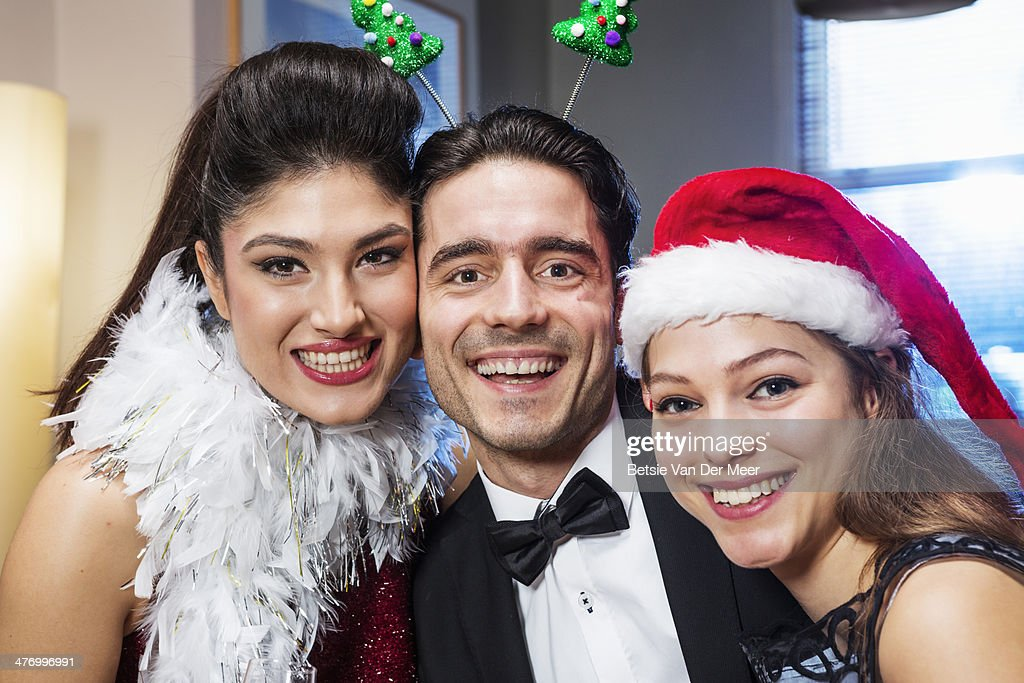 Groupsportrait of 3 people at Christmas. : Stock Photo