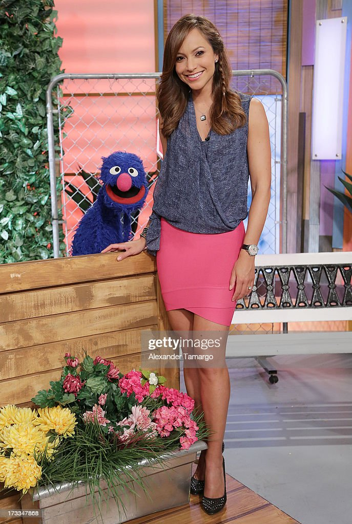 Grover and Satcha Pretto are seen during Sesame Street's visit of Univision's 'Despierta America' at Univision Headquarters on July 12, 2013 in Miami, Florida.