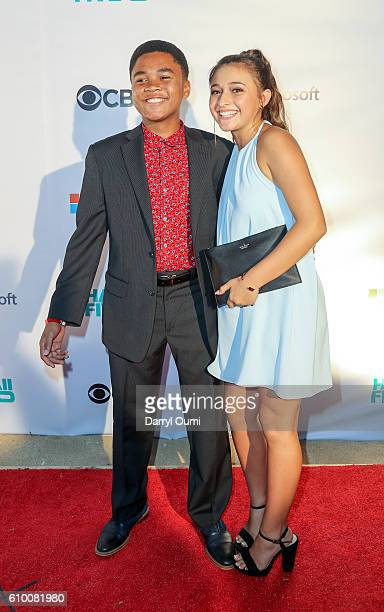 Grover McBride and actor Teilor Grubbs pose for a photo as they arrive at the CBS 'Hawaii Five0' Sunset On The Beach Season 7 Premier Event at...