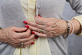 Grow old beautifully. Elderly woman getting ready to go out, active senior lifestyle. Close up of female manicured hands with rings, jewellery, fashion details