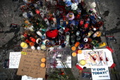 A growing memorial is viewed for Eric Garner near where he died after he was taken into police custody in Staten Island last Thursday on July 22 2014...